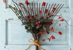 "CUTE door ""wreath"" from an old leaf rake!"