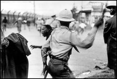 """The police loads short of bat on the demonstrators of the """"African National Congress,"""" Photo credit: Ian Berry — at Johannesburg Diepkloof Soweto"""