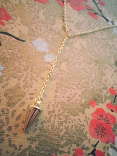 Gold Spike Lariat Necklace by KoreisKreations on Etsy, $17.99