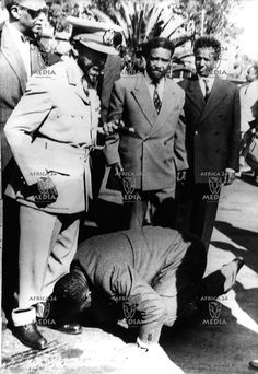 Gallery of Emperor Haile Selassie | AFRICA,ETHIOPIA-A loyal official kisses the feet of Haile selassie ...