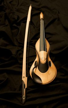 I'd love to see one of my fiddler friends get their hands on something that looks this cool.  I only hope it sounds just as lovely.