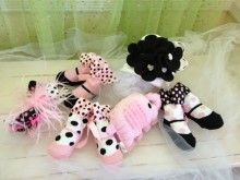Pink and Black: White Hat with Black Felt Flower, Three Pairs of Socks with Polka Dots, Hair Bow and Rattle