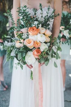 Green and peach wedding bouquet | Image by Athena Grace