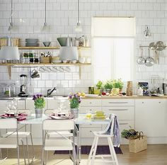 I love the idea of fully tiled walls in kitchens