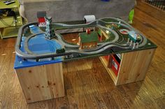 """Home made thomas train table with ikea storage bins as legs...Brilliant...we are in the process of making one for Easton from """"Santa Claus"""""""