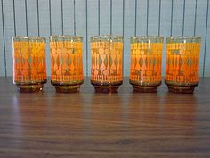 Set of 5 Amber Libbey Juice Glasses with Mod Orange Pattern.