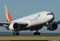 An Asiana B777 touching down on a beautiful Autumn morning at Sydney Airport