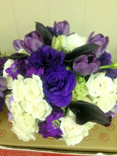 Luxe Petal designs, purple tulips, purple calla lilies, light green roses, white roses, and hydrangeas