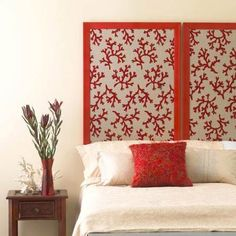 Create a framed headboard from a graphic print. Stretch fabric over heavy cardboard or foam-core board and secure on the back. Insert the panels into two inexpensive poster frames spray-painted a coordinating color. You could also use several picture frames with the glass removed.