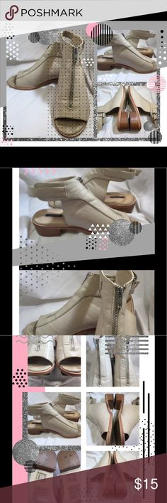 """Tan Ankle Strap Covered Sandals 9.M Beautiful like new tan/cream sandals 9M.  They have faux zippers down the covered front of the shoes.  The heels are 3/4"""" and are wooden. They are preowned in very good, not pristine but almost like new condition. Shoe interiors and exteriors show minimal signs of wear. The soles do show some wear. See pictures. Feel free to ask questions or for extra pictures. From a smoke free home with pets. unknown Shoes Sandals"""
