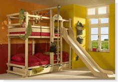Bunk bed with slide and rope swing.Kid Spaces We Love at Design Connection, Inc. | Kansas City Interior Design http://designconnectioninc.com/portfolio/ #KidSpaces #KidsRooms #InteriorDesign