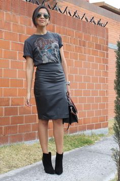 A t-shirt tucked into a leather pencil skirt