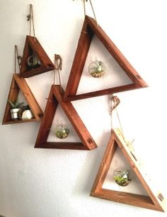 These items are made from reclaimed pallet wood. They are part of a small collection titled Inception. They are ready to hand with the rope and come as you see in the photos. There are 3 different Triangles, large Inception Triangle Planter ($60.00), small Inception Triangle Planter ($50.00), and large Inception Shelf ($40.00).