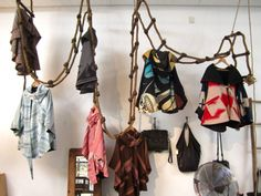 Clothing hanging from suspending rope ladders. Great way to make use of vertical space if your sq ft is small.