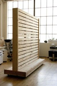 This wall partition is a fun and useful way to separate space in offices with an open layout. Heavy duty locking casters allow the structure to be moved and set in place with ease. The piece is mad…