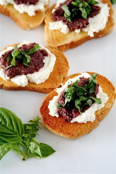 Bruschetta with Black Olive Pesto, Ricotta, and Basil - This bruschetta is amazingly simple to put together, and, all the components can be made well in advance and thrown together at the last second.