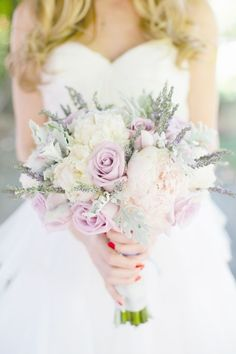 We love this soft, romantic bouquet! It would look gorgeous with dove gray bridesmaids' dresses, or even a soft sage green! Stunning!