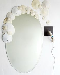 A basic ready-made frameless mirror is inexpensive and ready for artistic embellishment.