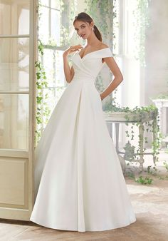 Mori Lee 5712 Providence Portrait Neckline Wedding Gown Styled in peau de soie, this Mori Lee Blu 5712 Providence off-the-shoulder bridal ball gown features a side gathered bodice with … Western Wedding Dresses, Bridal Wedding Dresses, Wedding Dress Styles, Dream Wedding Dresses, Lace Wedding, Prom Dresses, Mori Lee Wedding Dress, Event Dresses, Trendy Wedding