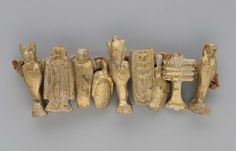 String of Egyptian gilt-wood funerary amulets | Museum of Fine Arts, Boston