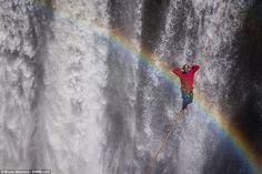 Somewhere over the rainbow: Seemingly without a care in the world, this man waves as he wa...