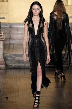 Julien Macdonald   Fall 2016 Ready-to-Wear   22 Black sleeveless midi dress with front slit and mesh panels