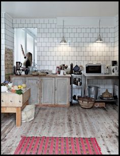 """square white tiles in brick pattern, dark grout, """"limed"""" wood cupboards"""