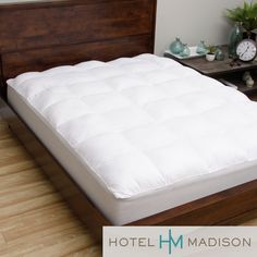 The top fabric of this memory fiber mattress pad is a 280 thread count brushed microfiber for softness. The pad has true baffle box construction to hold the fiber polyester filling material in place with more loft.