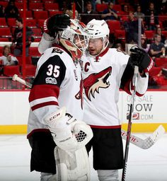 RALEIGH, NC - MARCH 03: Shane Doan #19 of the Arizona Coyotes congratulates Louis Dominique #35 on the win following an NHL game against the Carolina Hurricanes on March 3, 2017 at PNC Arena in Raleigh, North Carolina. (Photo by Gregg Forwerck/NHLI via Getty Images)