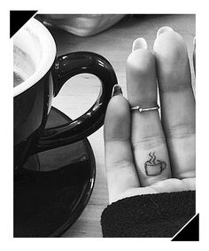 Cup of coffee finger tattoo Oh My God! I have no tattoos but would definitely consider THIS! Probably on my pointer finger tho - so I could see it. Pretty Tattoos, Love Tattoos, Beautiful Tattoos, Body Art Tattoos, New Tattoos, Tattoos For Women, Mini Tattoos, Small Tattoos, Hidden Tattoos