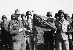 Legionnaires of the Turkestan Legion with one of their German officers and an Islamic unit flag.