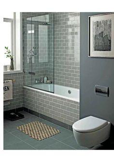 Gray bathroom Perfect sanctuary Retro Metro Holland Park tiles + slate floor + Geo square basins + Logic built-in tub via Fired Earth Inspiration online brochure  firedearth.com