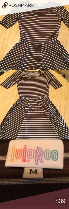 """LuLaRoe Brown Stripe Knit Nicole Dress Twirl Skirt LuLaRoe  Brown Stripe Nicole Knit Dress Rayon, Polyester, Lycra, Cotton and Nylon Size Medium Measures approximately  17"""" across front bustline  12"""" sleeve length  41"""" length from shoulder seam to bottom of skirt Very Good Previously Worn Condition LuLaRoe Dresses"""