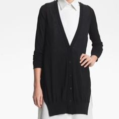 Alexander Wang Black Jersey Cardigan large NWT Still available but unable to ship until 1-30. . Alexander Wang Black Jersey Cardigan w/ ribbed back panel adds an element of translucence to a super soft jersey cardigan designed with a dramatically longer front.  Button front.  L NWT Alexander Wang Jackets & Coats