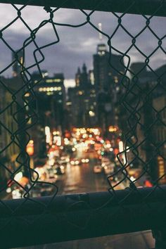 The city through the lense of a broken wire fence