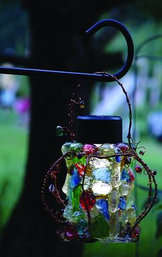 Whimsical solar lantern made of different types of glass, beds and copper wire. Put in your garden and light your path.