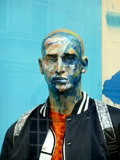 The mannequins at Harvey Nichols are daubed in the same abstract style as the paintings by Andrew Salgodo