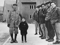 Holocaust concentration camp victims.  Looks like purple triangles on man and child on left