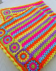 granny sqaures and stripes blanket by riavandermeulen - just a picture, love the stripes and granny square mix and the colors!!  Looks like Attic 24's Granny Stripe OR Drops pattern.