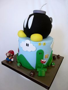 Top Ten best Super Mario cakes and cupcakes ever! Everything from Mario Kart to traditional Mario. Video game wedding cakes to birthday cakes. Prepare to Geek Super Mario Torte, Cupcakes Super Mario, Bolo Super Mario, Crazy Cakes, Fancy Cakes, Cute Cakes, Mario Bros Kuchen, Mario Bros Cake, Luigi Cake