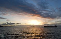 The sun sets over Elliott Bay in Seattle
