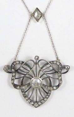 Liberty & Co. - An Art Nouveau pendant set with diamonds. #Liberty #ArtNouveau #pendant