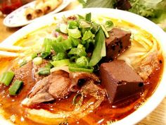 Bun Bo Hue - Slices of well-cooked tenderloin beef, pork balls in beef broth with lemon grass.    yes, its spicy but to die for!
