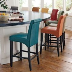 I love these Grandin Road stools. Lots of colors. Leather Valencia Bar Stools