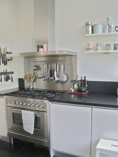 Mount knives on wall and cooking utensils over the stove - Brilliant