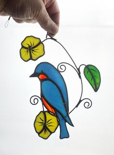 Beautiful Eastern Bluebird stained glass bird sun catcher. Approx. size 7.5 x 6 My own original design, hand-crafted with stained glass. Each piece of high-quality stained glass is cut, copper-foiled and soldered in my home studio. Free Suction cup included. To see the rest of our shop: