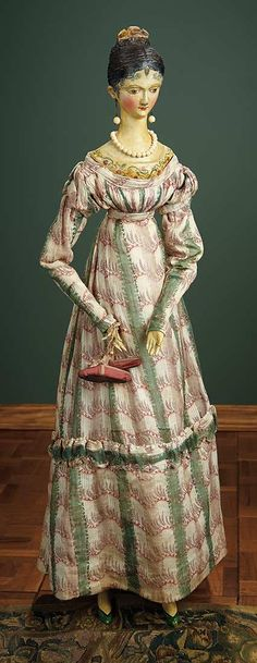 Grodnertal doll, ca 1830, wearing a costume comprising gown, undergarments, silk slippers, jewelry.
