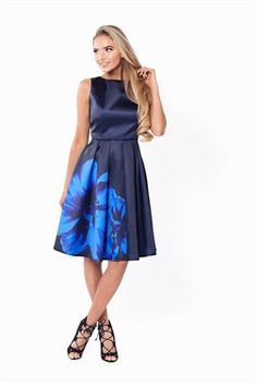 Sistaglam Shay Satin Prom Dress With Oversized Floral Print  £65.00 Add a touch of floral with this satin prom dress. Features a styled full skirt and an oversized flower print. Style with pearls and red lippy for serious Betty Draper vibes.   Colour: Navy