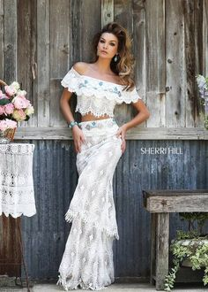Bohemian off the shoulder two piece features layered crochet lace, and pops of turquoise beading on the chest and waist.