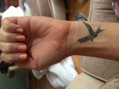 Swallow wrist tattoo